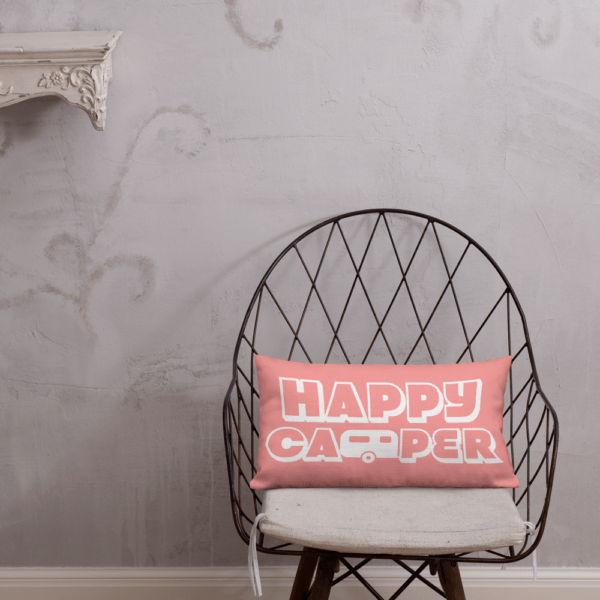 Happy Camper Rectangular Pillow in Pretty in Pink on a chair