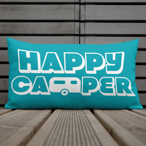 Happy Camper Rectangular Pillow in Seaside Blue on the deck