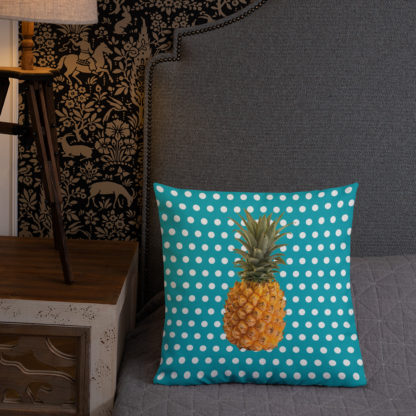 Pineapple and Polka Dots Pillow in bed in Seaside Blue