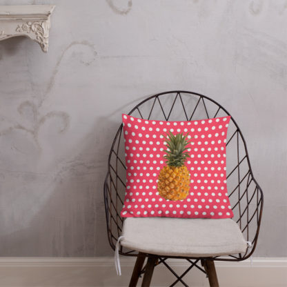 Pineapple and Polka Dots Pillow on a chair in Cotton Candy Pink