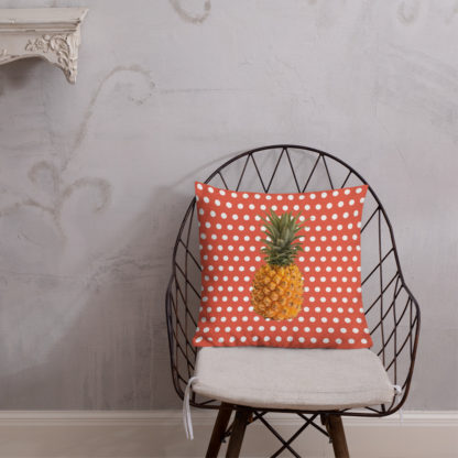 Pineapple and Polka Dots Pillow on a chair in Orange Glo