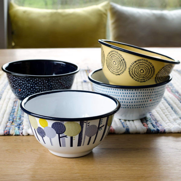 Wild & Wolf Folklore Enamel Day Design Serving Bowls on table