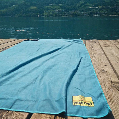 Wise Owl Outfitters Microfiber Camping Towel in Marine Blue on dock